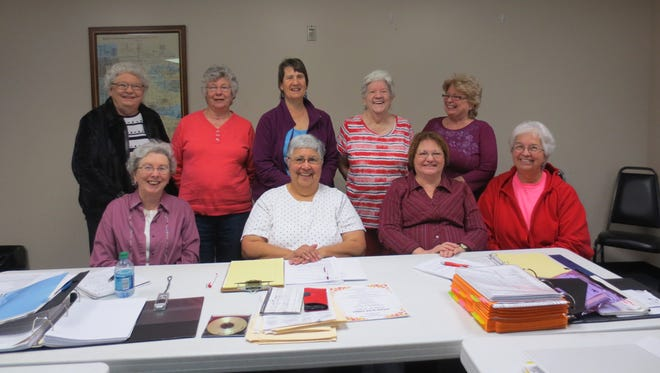 Hill 'N Hollow Quilters 2017 Board members plan for October 19,20, 21 Autumn in the Ozarks Quilt Show.  Sitting Donna Bohaty, secretary, from left; Connie Randall, president; Diana Arikan, interim treasurer; and Joyce Linhoff, vice president/night liaison). Standing are Carol Lewis, audi; Joyce Pavol, hospitality; Peggy Moody, communications; Margie Dotson, president-elect; and Sue Herron, membership. For more information on the guild or the upcoming October Show, visit www.hillnhollowquilters.com.