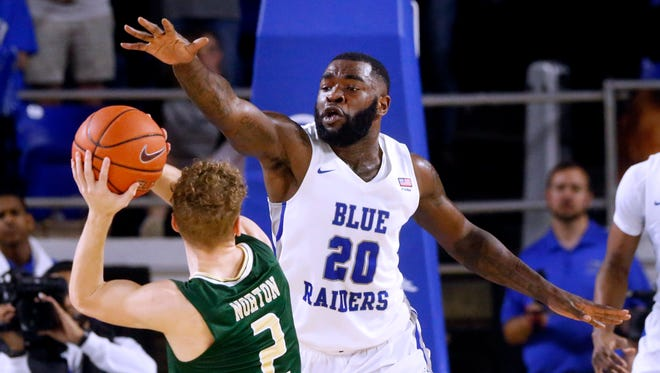 UABÕs (2) goes up for a shot as MTSU's Giddy Potts (20) defends him on Saturday, Feb. 24, 2018, at MTSU.