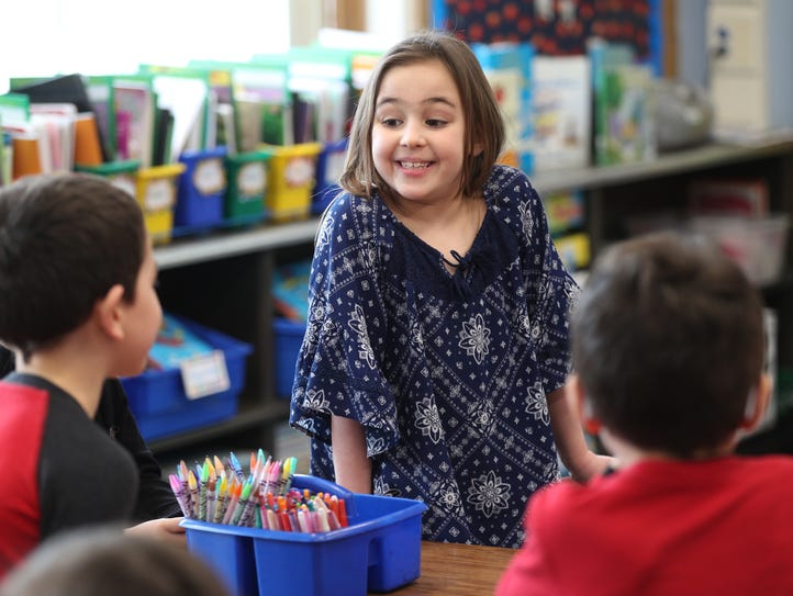First-grader Margaux LoVerdi, after reading a story