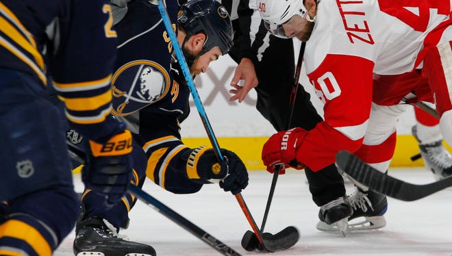 Buffalo Sabres forward Ryan O'Reilly, left, and Detroit Red Wings Henrik Zetterberg battle for the puck Nov. 23, 2016, in Buffalo, N.Y.