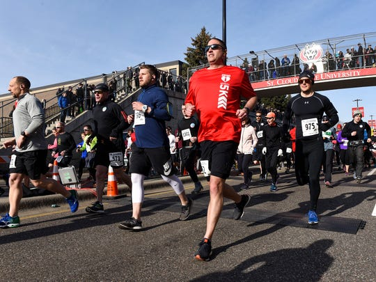 Runners start the 2018 Earth Day Half Marathon on University Drive Southeast in St. Cloud.
