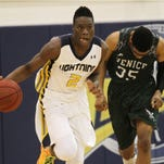Lehigh's Emmitt Williams drives up the court after a rebound during the Region 6A-3 quarterfinals against Venice.