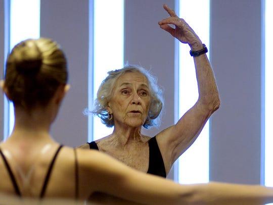 Ballet dance instructor Jeanne Bochette coaches students