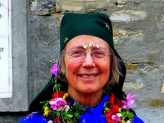 This photo of Jennifer L. Thompson was taken at the Mother's Union Ceremony in Ghalegaun Village, Nepal. They put rice on her forehead for a blessing.