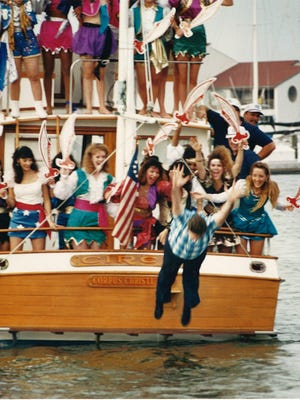 Mayor Pro Tem Joe McComb is thrown into Corpus Christi Bay by the Buc Days pirate queens April 25, 1991.