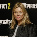 FILE - In this Thursday, 30 April, 2015 file photo, Kate Moss poses for photographers at the screening of Pitch Perfect 2 in central London. Supermodel Kate Moss has been escorted off a plane, Sunday June 8, 2015, after reportedly being disruptive while traveling from Turkey to Londons Luton airport.