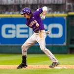 LSU's Mark Laird celebrates after hitting a double during a game earlier this season.