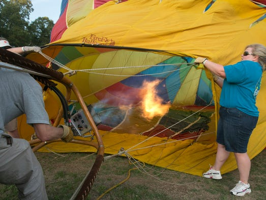 "Pilot Clarke Harbold prepares for a ""static show"" with help from crew Will and Heather Stephens during Aloft 2014 in Simpsonville."