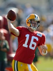 Green Bay Packers quarterback Scott Tolzien makes a throw while running drills during training camp practice at Ray Nitschke Field on Thursday, Aug. 6, 2015.