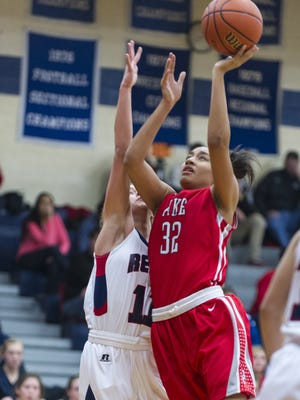 Pike High School senior Tyana Robinson (32) takes the ball to the basket to score during first half action. Roncalli High School hosted Pike High School in girls' varsity basketball action, Saturday, Nov. 15, 2014.