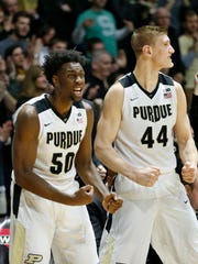 Caleb Swanigan and Isaac Haas react on the Purdue bench after Vince Edwards scored and drew a foul on Kenny Goins of Michigan State with 1:12 remaining in regulation Tuesday, February 9, 2016, at Mackey Arena. Purdue defeated Michigan State 82-81 OT.