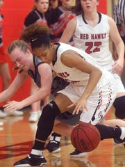 Stewarts Creek's Brianah Ferby (32) goes after a loose ball with Coffee County's Bailey Morgan (22) on Friday, Feb. 24, 2017 the quarterfinal round of Regional play.