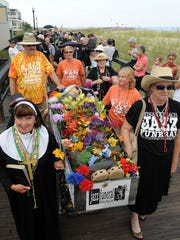 Mourners move the casket down the Bethany Beach boardwalk