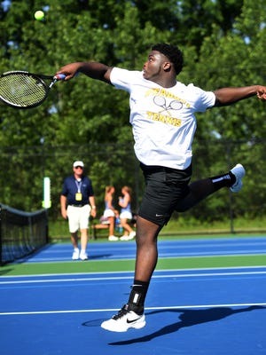 Peabody's Robert Clark returns a volley during the 2018 TSSAA Small Class State Boys' Doubles tennis tournament, Thursday, May 24.