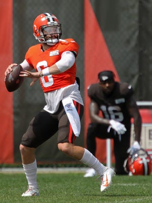 Browns quarterback Baker Mayfield looks downfield for an open receiver during practice last month.
