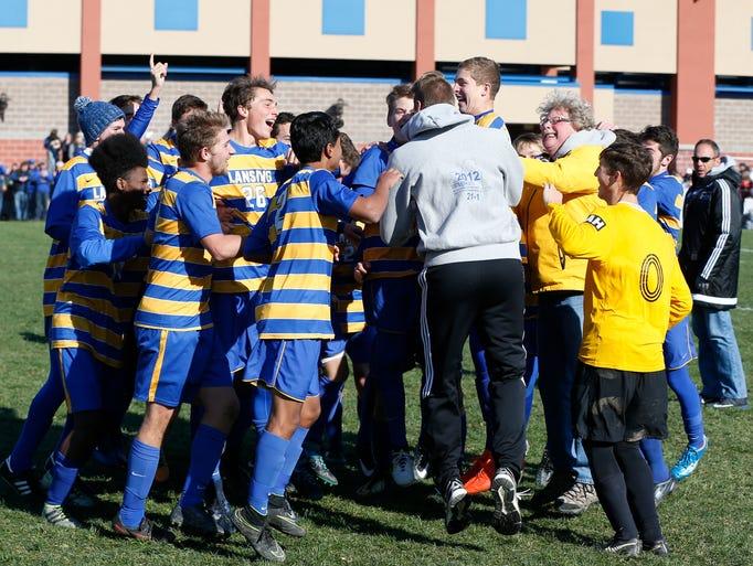 Lansing's boys soccer team celebrate their win over