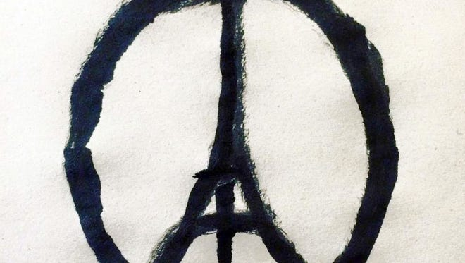"""A handout photo provided on November 14, 2015 by Jean Jullien Studio Ltd shows the """"#PeaceForParis"""" logo. At least 128 people were killed in gun and bomb attacks in the French capital on November 13, in what French President Francois Hollande called """"an act of war."""""""