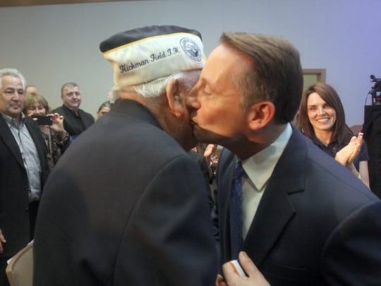 Westchester County Executive Rob Astorino kisses Armando