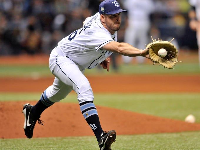 Tampa Bay Rays reliever Adam Kolarek fields a ground