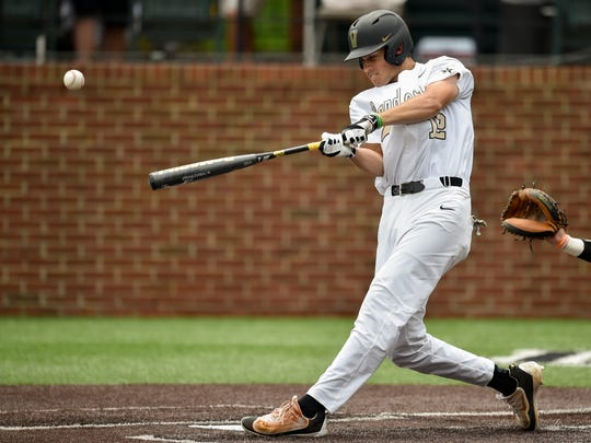 Vanderbilt's Connor Kaiser (12) lines out during the second inning of a NCAA Regional baseball game against Xavier at Hawkins Field, Saturday, June 4, 2016, in Nashville, Tenn.