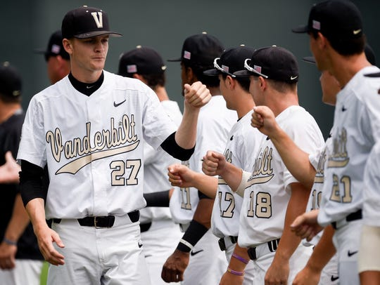 Vanderbilt pitcher Chandler Day (27) greets teammates