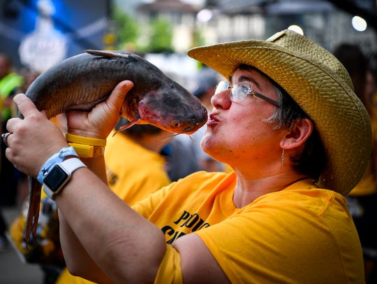 Penny Starr, of Lebanon, Tenn., poses with a catfish
