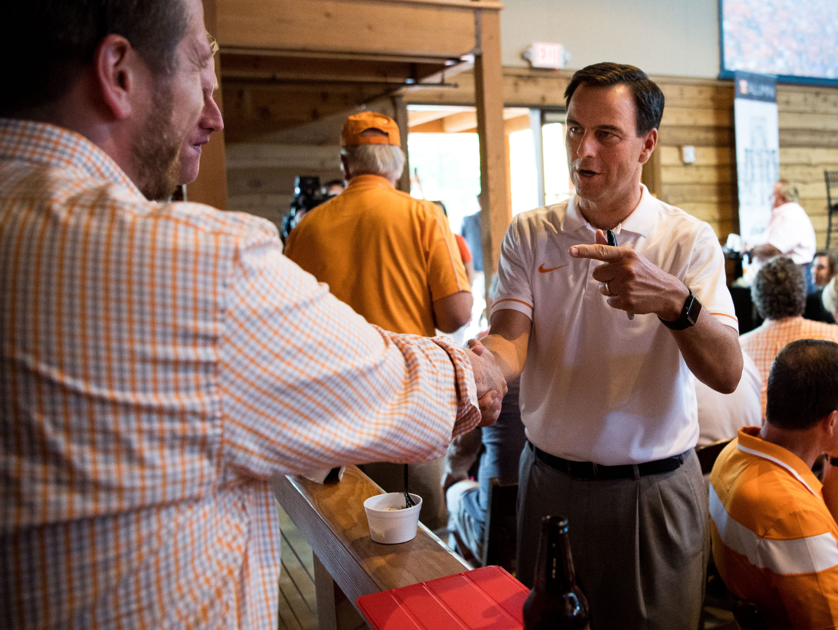 John Currie, University of Tennessee vice chancellor and director of athletics, greets fans during a Big Orange Caravan event at The Barn at Sycamore Farms in Arrington, Tenn., Monday, July 10, 2017.