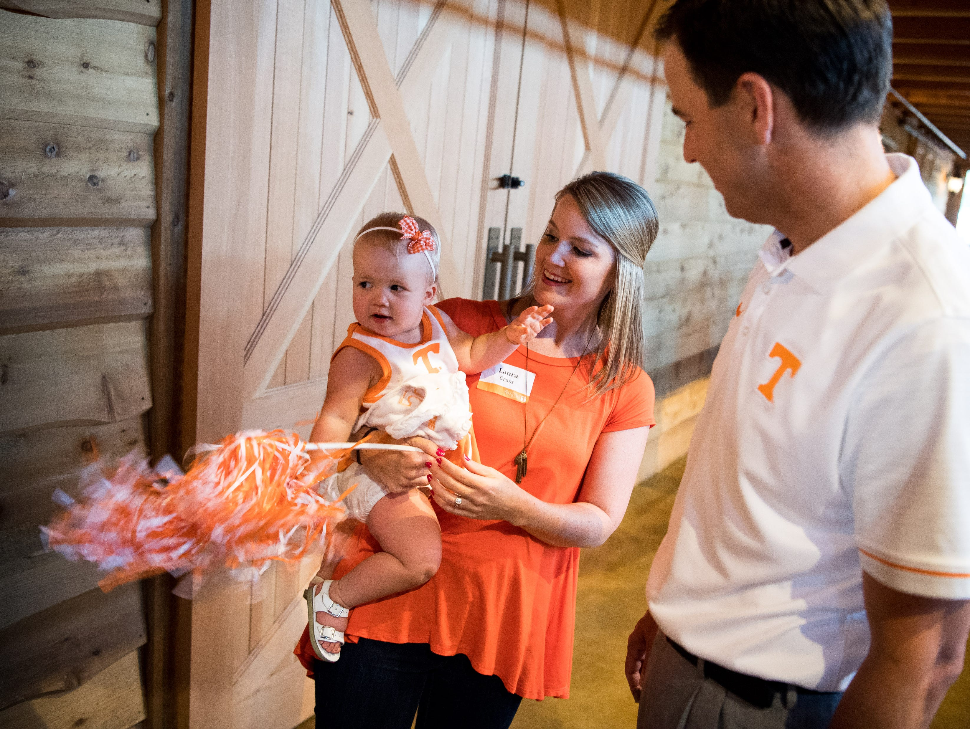 John Currie, University of Tennessee vice chancellor and director of athletics, greets Laura Grass and her 16-month-old daughter Caroline during a Big Orange Caravan event at The Barn at Sycamore Farms in Arrington, Tenn., Monday, July 10, 2017.