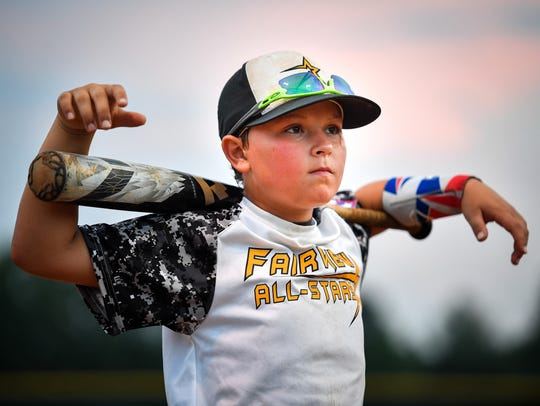Fairview 12U Baseball All Stars Kylan Keller listens