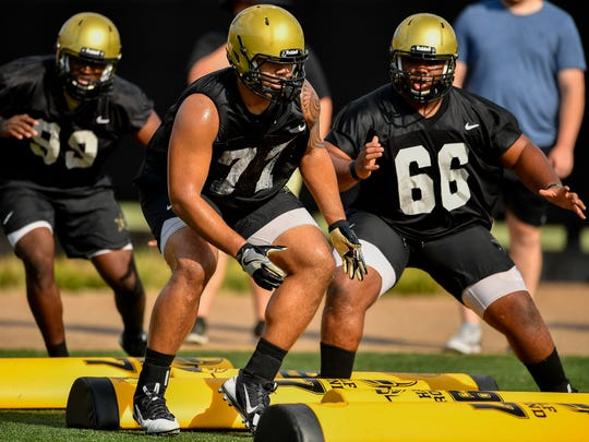 Vanderbilt defensive lineman Nifae Lealao runs drills