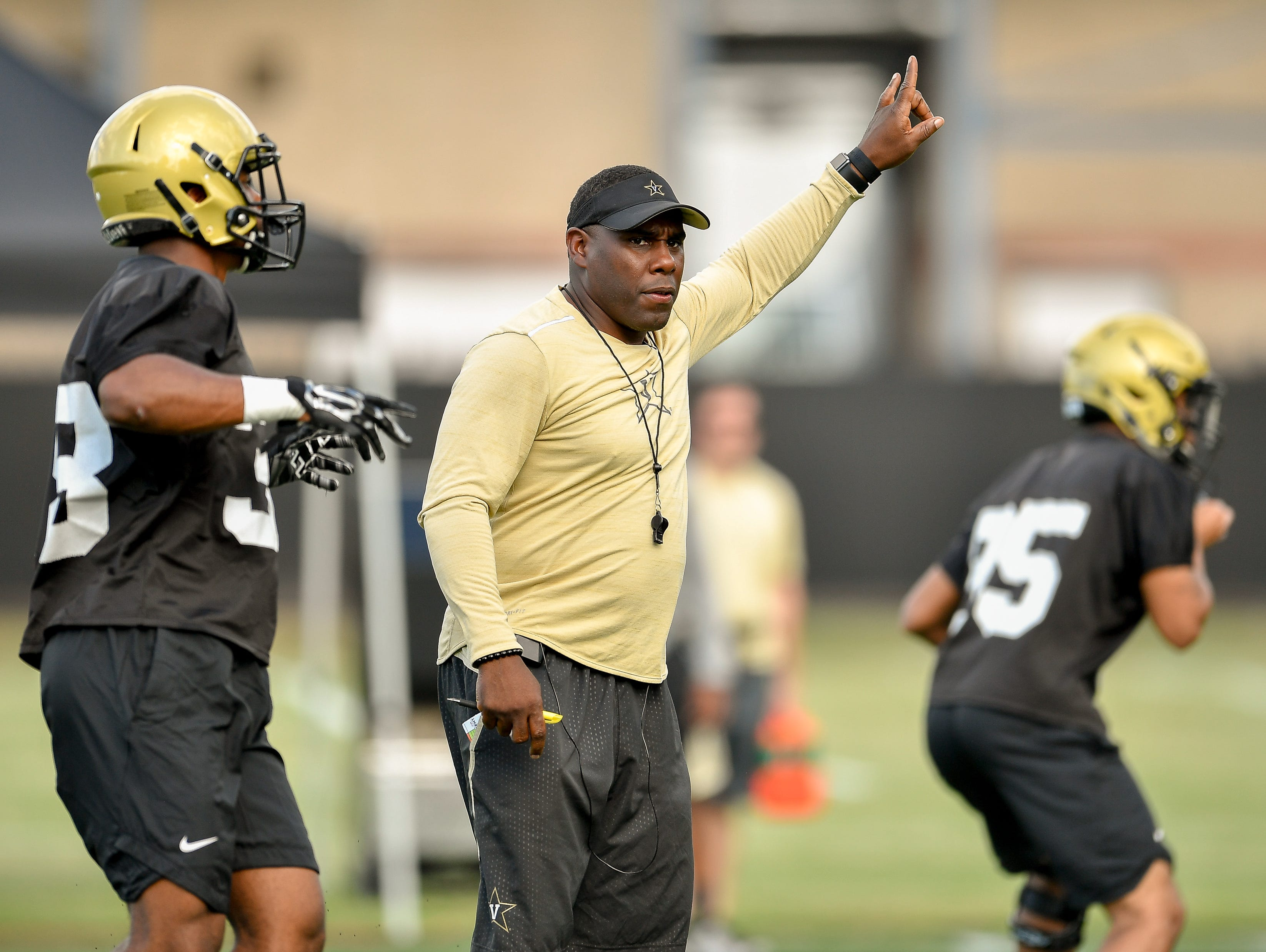Vanderbilt coach Derek Mason works with his team during the first football practice of preseason camp Monday, July 31, 2017.