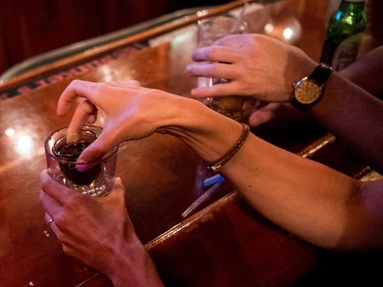Customers drop a shot of MoonPie Moonshine and raspberry