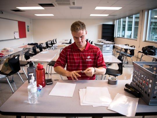 Jack Kozlowski, a math teacher, works on preparing