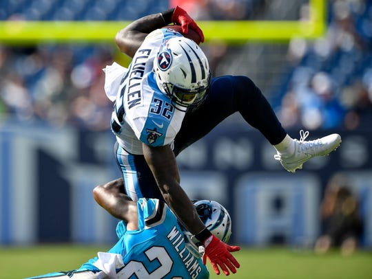 Tennessee Titans running back David Fluellen (32) leaps