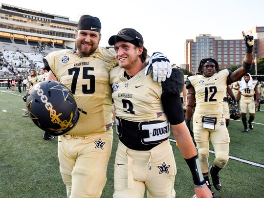 Vanderbilt offensive lineman Bailey Granier (75) and quarterback Shawn Stankavage (3) celebrate after their victory against Alabama A&M on Saturday, Sept. 9, 2017.