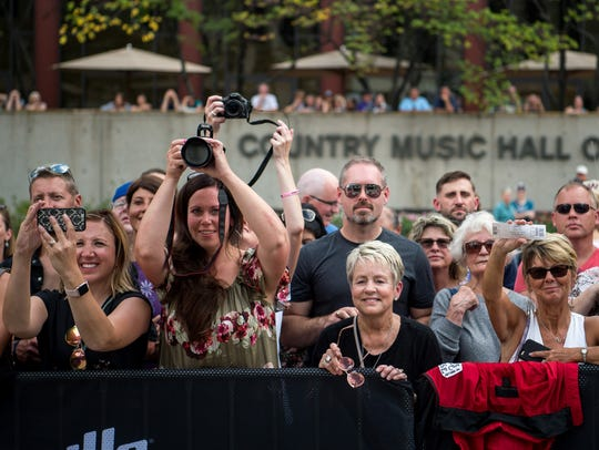 Fans take pictures of Little Big Town during an induction