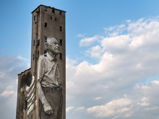 A painting by Australian artist Guido van Helten is seen on a 200-foot-tall abandoned grain silo in The Nations.