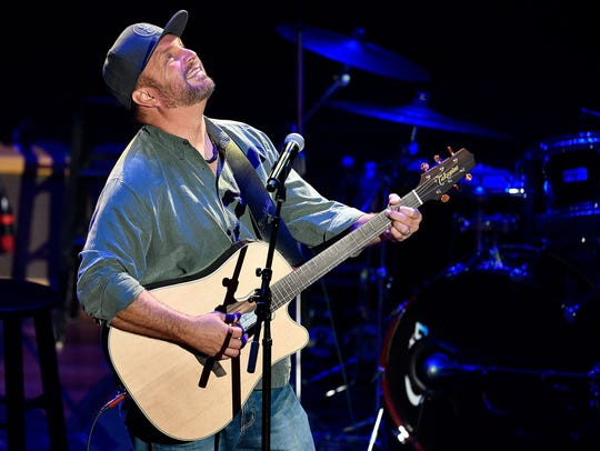 "Garth Brooks and Kent Blazy perform ""If Tomorrow Never Comes"" during the NSAI 50 Years of Songs concert at the Ryman Auditorium in Nashville on Sept. 20, 2017."