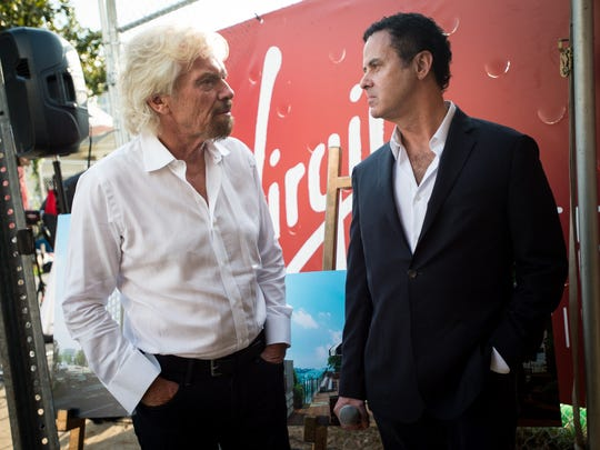 Sir. Richard Branson, left, and Virgin Hotels CEO Raul Leal chat at the site of the future Virgin Hotels Nashville in Nashville, Tenn., Wednesday, Sept. 20, 2017.