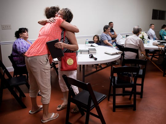 Denise Brimm, left, hugs Catherine Dickerson, right, during Wednesday service at Burnette Chapel Church of Christ in Antioch, Tenn., Wednesday, Sept. 27, 2017. Dickerson was wounded in Sunday's shooting following a service at the church.