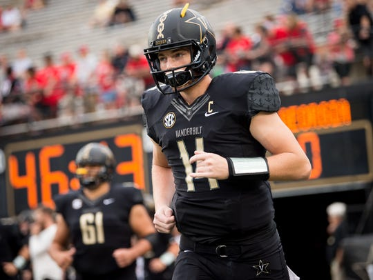 Vanderbilt quarterback Kyle Shurmur (14) heads out