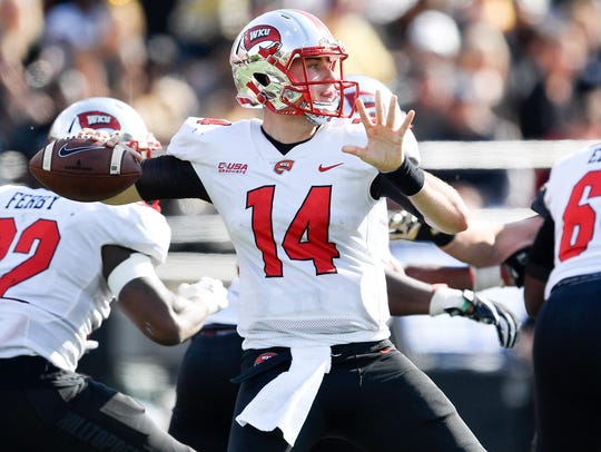 Western Kentucky quarterback Mike White (14) passes