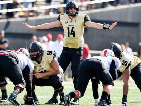 Vanderbilt quarterback Kyle Shurmur (14) signals to his team against Western Kentucky during the second half at Vanderbilt Stadium in Nashville, Tenn., Saturday, Nov. 4, 2017.