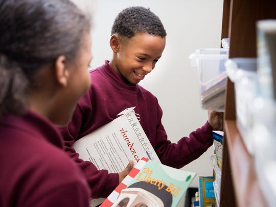 Third grader Joseph Hegwood picks out a book to read