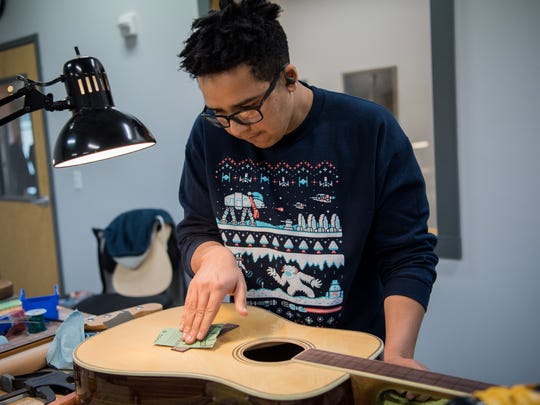 Student Jose Collazo works on the bridge of the acoustic guitar he is building at the Guitar Craft Academy in Nashville, Tenn., Thursday, Dec. 14, 2017.
