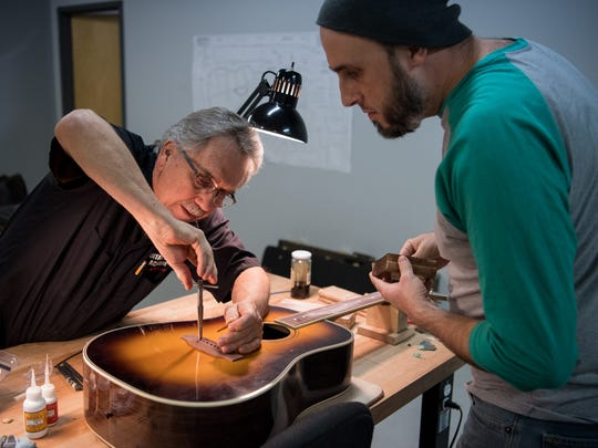 Instructor Marty Lanham, left, assists student Clayton March with his acoustic guitar at the Guitar Craft Academy in Nashville, Tenn., Thursday, Dec. 14, 2017.