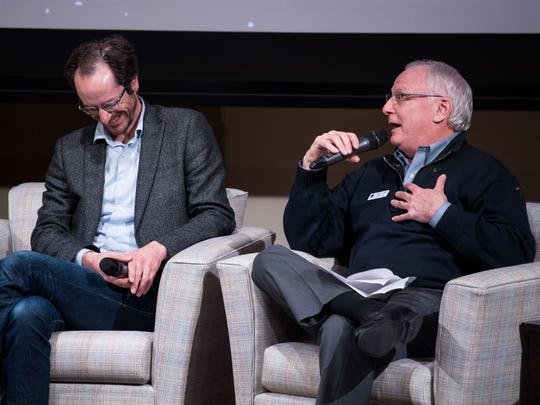 """Freddie O'Connell, left, Metro councilman, District 19, reacts as Floyd Shechter, right, president and CEO of Smart Space, speaks during the """"Costs of Growth and Change in Nashville"""" event at the Nashville Public Library in Nashville, Tenn., Wednesday, Dec. 20, 2017."""
