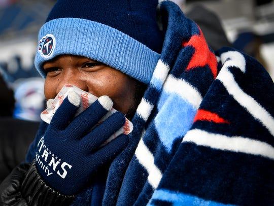 Steven Dalton, of Nashville, warms his face with a