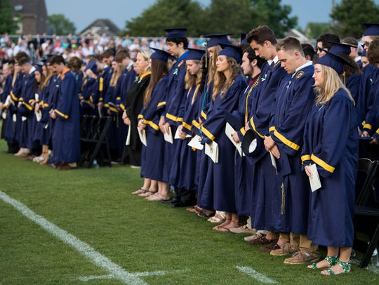 Graduates observe a moment of silence for Megan Fitzgerald