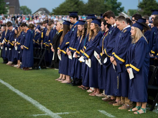 Graduates observe a moment of silence for Megan Fitzgerald during Independence's graduation ceremony at Independence High School, Friday, May 18, 2018, in Thompson's Station, Tenn.